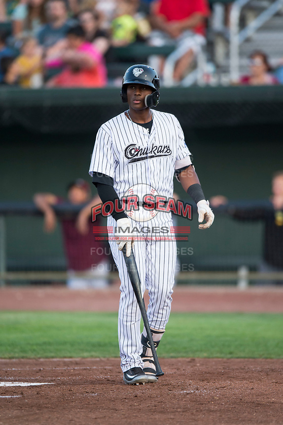 Idaho Falls Chukars third baseman Angel Medina (46) walks towards the batter's box during a Pioneer League game against the Great Falls Voyagers at Melaleuca Field on August 18, 2018 in Idaho Falls, Idaho. The Idaho Falls Chukars defeated the Great Falls Voyagers by a score of 6-5. (Zachary Lucy/Four Seam Images)