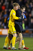 Dean Henderson of Shrewsbury Town escorts a Shrewsbury Town fan off the pitch during the Sky Bet League 1 match between Shrewsbury Town and Bradford City at Greenhous Meadow, Shrewsbury, England on 25 November 2017. Photo by Thomas Gadd.