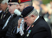 Pictured: An ex serviceman wipes away tears during the minute's silence Friday 11 November 2016<br />Re: Remembrance Day service at Castle Square Gardens in Swansea, south Wales, UK.