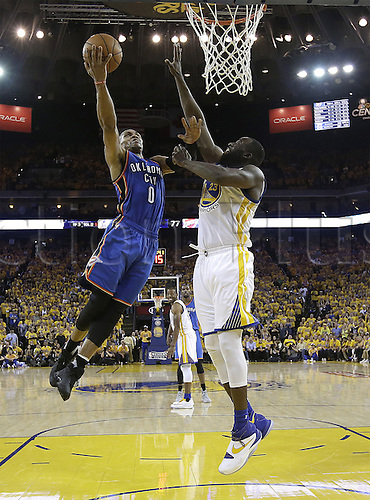30.05.2016. Oakland, California, U.S - Oklahoma City Thunder guard Russell Westbrook (0) shoots against Golden State Warriors forward Draymond Green during the second half of Game 7 of the NBA basketball Western Conference finals in Oakland, Calif., Monday, May 30, 2016. The Warriors won 96-88 to go through to the best of 7 finals versus Cleveland.
