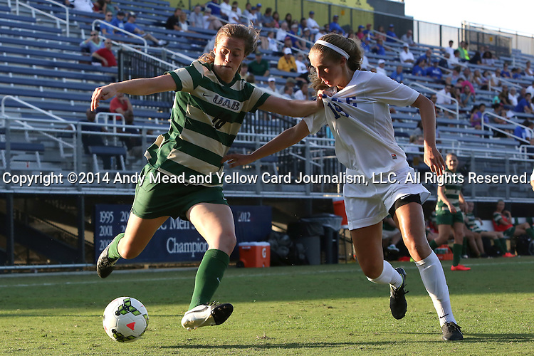 31 August 2014: UAB's Sharon Osterbind (18) and Duke's Schuyler DeBree (right). The Duke University Blue Devils hosted the University of Alabama Birmingham Blazers at Koskinen Stadium in Durham, North Carolina in a 2014 NCAA Division I Women's Soccer match. Duke won the game 3-1.