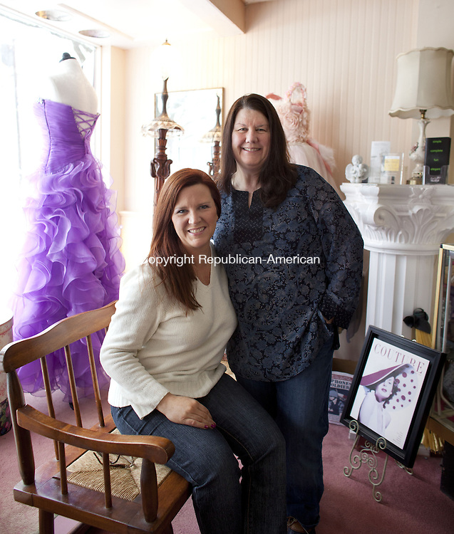 WATERTOWN, CT-5 February 2014-020514BF03-  Sisters Natalie Testa, owner of Ragtime Boutique, left, and Gail Capolupo, owner of My Sister's Baggage pose for a portrait inside Ragtime Boutique in Watertown. The two take older wedding gowns and other items and repurpose them into purses, bags, bridal garters baptism gowns and handkerchiefs.  Bob Falcetti Republican-American