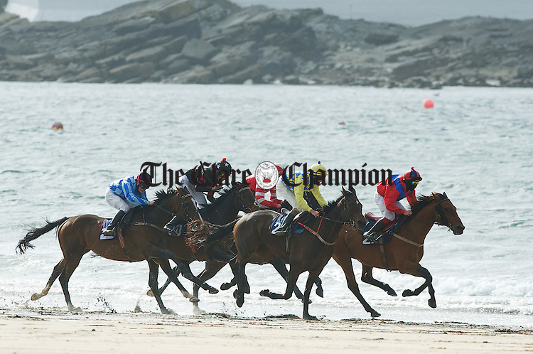 Horses and riders make their way across the horse shoe beach during the Strand Races in Kilkee. Photograph by John Kelly.