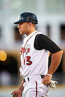 Lansing Lugnuts Gunnar Heidt (13) coaching first during a game against the Peoria Chiefs on June 6, 2015 at Cooley Law School Stadium in Lansing, Michigan.  Lansing defeated Peoria 6-2.  (Mike Janes/Four Seam Images)