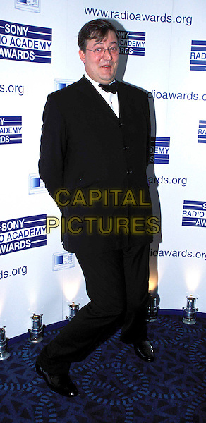 STEPHEN FRY.Sony Radio Academy Awards, Grosvenor House Hotel.Ref: AH.full length, full-length.www.capitalpictures.com.sales@capitalpictures.com.© Capital Pictures