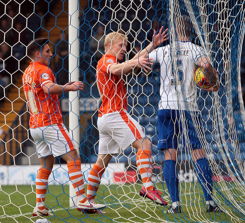 Blackpool's Mark Cullen tries to get the ball from Bury's Peter Clarke after scoring his sides first goal (2-1)<br /> <br /> Photographer David Shipman/CameraSport<br /> <br /> Football - The Football League Sky Bet League One - Bury v Blackpool - Saturday 31st October 2015 - Gigg Lane - Bury <br /> <br /> &copy; CameraSport - 43 Linden Ave. Countesthorpe. Leicester. England. LE8 5PG - Tel: +44 (0) 116 277 4147 - admin@camerasport.com - www.camerasport.com