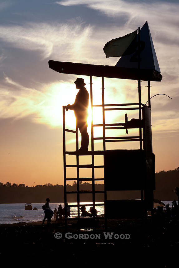 Lifeguard on observation tower at Lake Erie beach.