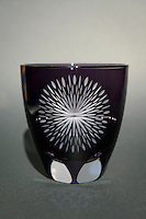 Edokiriko glass with a firework motif. Shimizu Glass, Tokyo, Japan, January 14, 2015. Edokiriko is a style of cut glass that dates back to 1834 and is similar to British cut glass. It makes use coloured glass and highly-intricate Japanese motifs.