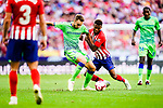 Lorenzo Moron of Real Betis (L) fights for the ball with Thomas Lemar of Atletico de Madrid (R) during the La Liga 2018-19 match between Atletico de Madrid and Real Betis at Wanda Metropolitano Stadium on October 07 2018 in Madrid, Spain. Photo by Diego Souto / Power Sport Images