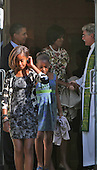 The First Family talks with Rev Luis Leon after church service at St John's Episcopal Church on September 19, 2010.  From left to right; Malia and Sasha Obama, United States President Barack Obama and First Lady Michelle Obama, and Reverend Luis Leon..Credit: Dennis Brack / Pool via CNP