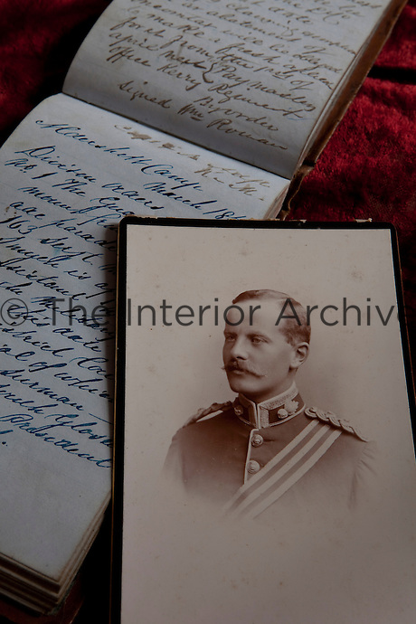 A photograph of Cecil Leslie as a young officer in the Royal Munster Fusiliers resting on a military notebook for the Kerry militia dated 1856