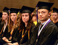 Douglas Hayduk (R) and some of his fellow graduates listen to a speaker during the 64th Commencement ceremony at Palisades High School Friday June 12, 2015 in Kintnersville, Pennsylvania.  (Photo by William Thomas Cain/Cain Images)