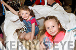 Niamh Healy and Caoimhe Carolan helping pack wool at the Top of Coom Shearing on Sunday.