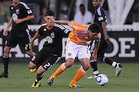 Houston Dynamo forward Brian Ching (25) shields the ball against DC United forward Pablo Hernandez (21)   The Houston Dynamo defeated DC United 3-1, at RFK Stadium, Saturday September 25, 2010.