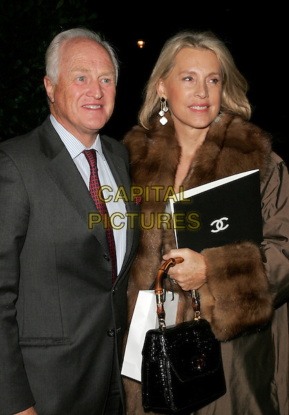 SIR WINSTON CHURCHILL & LUCE CHURCHILL .The Chanel pre Autumn / Winter Collection Show at Phillips de Pury & Co, Victoria, London, England. .December 6th, 2007 .half length brown fur coat grey gray suit jacket.CAP/AH.©Adam Houghton/Capital Pictures.