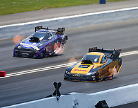 Jun 17, 2018; Bristol, TN, USA; NHRA funny car driver J.R. Todd (near) alongside Jack Beckman during the Thunder Valley Nationals at Bristol Dragway. Mandatory Credit: Mark J. Rebilas-USA TODAY Sports