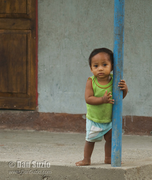 A child stands on the porch of a home in Vila, a small village on Atauro Island, Timor-Leste (East Timor)