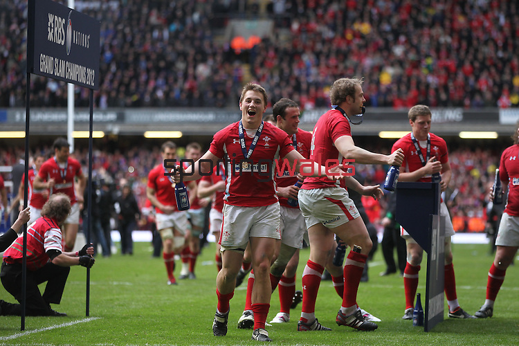Jonathan Davies celebrates the Grand Slam after victory over France..RBS 6 Nations 2012.Wales v France.Millennium Stadium.17.03.12..CREDIT: STEVE POPE-SPORTINGWALES