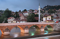 The Seher-Cehaja Bridge in the evening, a 16th century Ottoman bridge crossing the Miljacka river, and the minaret of the Hadzijska Mosque or Vekil Harc Mosque, built 1541-61, Sarajevo, Bosnia and Herzegovina. The city was founded by the Ottomans in 1461. Picture by Manuel Cohen