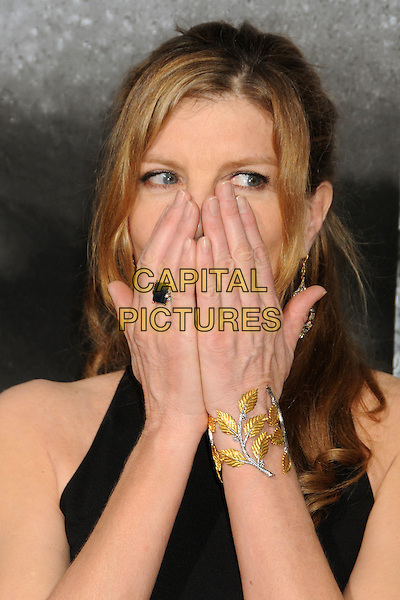 "Rene Russo.""Warrior"" World Premiere held at Arclight Cinemas, Hollywood, California, USA..September 6th, 2011.headshot portrait black hands covering mouth funny face gold bracelet leaf  leaves ring.CAP/ADM/BP.©Byron Purvis/AdMedia/Capital Pictures."