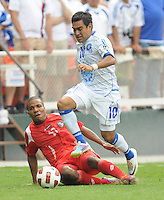 El Salvador Eliseo Quintanilla (10) runs with the ball against Panama Luis Enrriquez (17)   Team Photo.  Panama defeated El Salvador in penalty kicks 5-3 in the quaterfinals for the 2011 CONCACAF Gold Cup , at RFK Stadium, Sunday June 19, 2011.