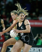 20.09.2008 Silver Ferns Sheryl Scanlan and Australia's Kimberley Green in action during the New World Netball test match between the Silver Ferns and Australia played at Vector Arena in Auckland Mandatory Photo Credit ©Michael Bradley.