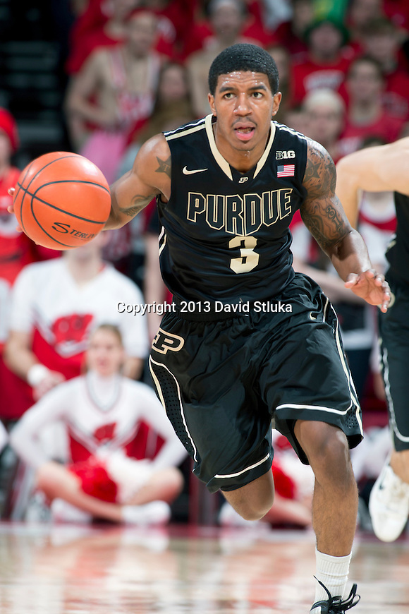 Purdue Boilermakers guard Ronnie Johnson (3) handles the ball during a Big Ten Conference NCAA college basketball game against the Wisconsin Badgers Sunday, March 3, 2013, in Madison, Wis. Purdue won 69-56. (Photo by David Stluka)