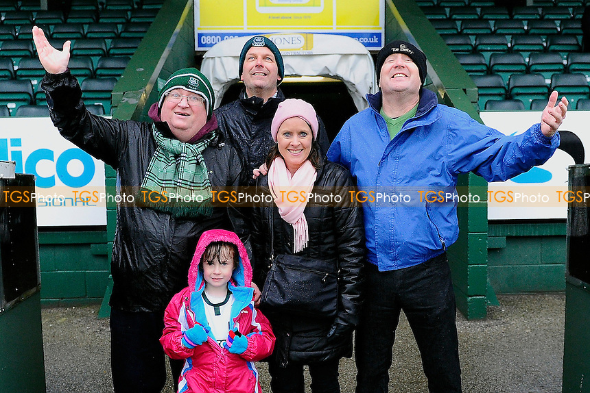 Plymouth Argylefans look to the sky as the rain comes down and the match is called off during Yeovil Town vs Plymouth Argyle, Sky Bet League 2 Football at Huish Park, Yeovil, England on 06/02/2016