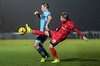 Garry Thompson of Wycombe Wanderers and Teddy Mezague of Leyton Orient (19) during the Sky Bet League 2 match between Wycombe Wanderers and Leyton Orient at Adams Park, High Wycombe, England on 17 December 2016. Photo by David Horn / PRiME Media Images.