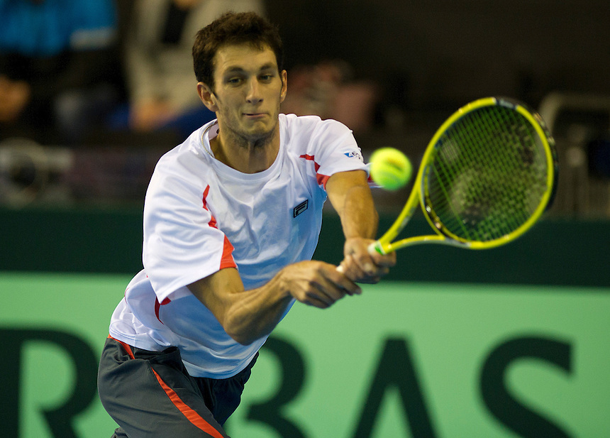 Great Britain's James Ward in action today during his singles match against Russia's Evgeny Donskoy.. - Credit - CameraSport - Stephen White..International Tennis -  - Davis Cup by BNP Paribas - Europe/Africa Zone Group I Second Round - Great Britain v Russia - Day 1 - Friday 5th April 2013 - Ricoh Arena - Coventry - UK..© CameraSport - 43 Linden Ave. Countesthorpe. Leicester. England. LE8 5PG - Tel: +44 (0) 116 277 4147 - admin@camerasport.com - www.camerasport.com