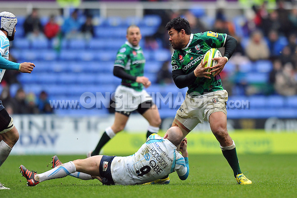 Ofisa Treviranus is tackled in possession. Aviva Premiership match, between London Irish and Worcester Warriors on March 23, 2013 at the Madejski Stadium in Reading, England. Photo by: Patrick Khachfe / Onside Images