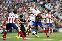 Pepe of Real Madrid and Miranda and Moya of Atletico de Madrid during La Liga match between Real Madrid and Atletico de Madrid at Santiago Bernabeu stadium in Madrid, Spain. September 13, 2014. (ALTERPHOTOS/Caro Marin)