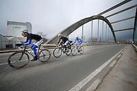Kenneth Vanbilsen (BEL/Topsport Vlaanderen-Baloise), Kris Boeckmans (BEL/Lotto-Belisol) &amp; James Vanlandschoot (BEL/Wanty-GroupeGobert) force the decisive break of the race<br /> <br /> Dwars Door Vlaanderen 2014