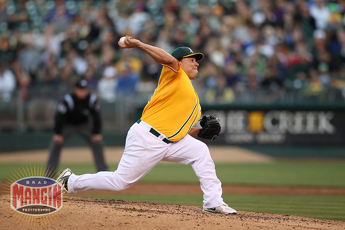 OAKLAND, CA - JULY 17:  Bartolo Colon #21 of the Oakland Athletics pitches against the Texas Rangers during the game at O.co Coliseum on Tuesday, July 17, 2012 in Oakland, California. Photo by Brad Mangin
