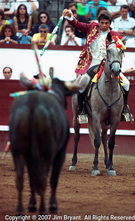 A calvalerio, a horseman, waits to plunge a barb into a bull on Terceira, Azores. Far out in the Atlantic Ocean, some 850 miles off the western coast of Lisbon, Portugal lies the 425-mile long archipelago of the Azores. (Jim Bryant Photo)....