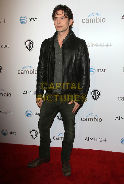 "Jackson Rathbone.""Aim High"" Los Angeles Premiere held at Trousdale, West Hollywood, California, USA..October 18th, 2011.full length black leather jacket grey gray shirt jeans denim .CAP/ADM/KB.©Kevan Brooks/AdMedia/Capital Pictures."