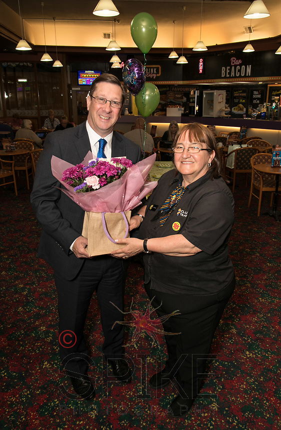 Brenda Ancliff retires from Beacon Bingo in Ilkeston after 30 years. Brenda is pictured receiving a bunch of flowers from Operatons Manager Phil Gibbs