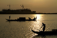 Fishing above the craves of an hotel built in Phnom Penh, on the banks of  the Tonle Sap river, Cambodia-2011