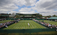A general view of the outer courts with centre court in the background<br /> <br /> Photographer Rob Newell/CameraSport<br /> <br /> Wimbledon Lawn Tennis Championships - Day 2 - Tuesday 2nd July 2019 -  All England Lawn Tennis and Croquet Club - Wimbledon - London - England<br /> <br /> World Copyright © 2019 CameraSport. All rights reserved. 43 Linden Ave. Countesthorpe. Leicester. England. LE8 5PG - Tel: +44 (0) 116 277 4147 - admin@camerasport.com - www.camerasport.com