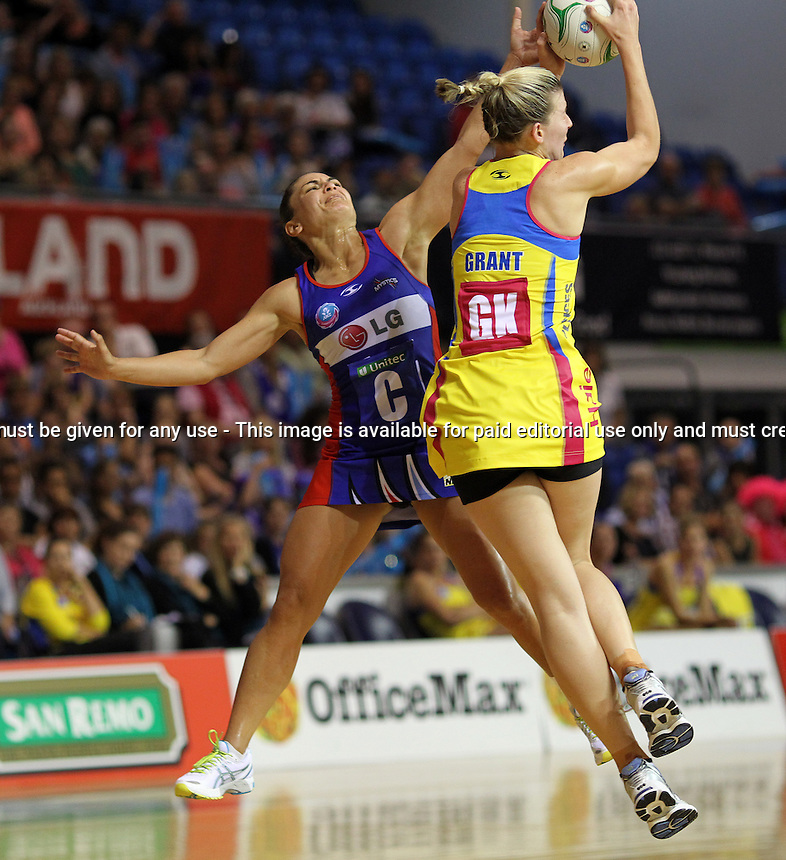 01.04.2012 Mystics Temepara George and Pulse's Katrina Grant in action during the ANZ Champs netball match between the Mystics and the Pulse played at Trusts Stadium in Auckland. Mandatory Photo Credit ©Michael Bradley.