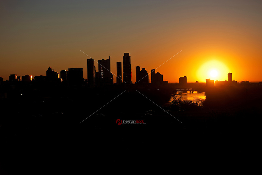 Austin skyline silhouette as the sun pops above the horizon signaling another beautiful day in the Live Music Capital of the World, Austin, Texas, USA