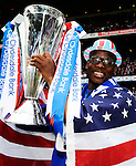 9TH MAY 2010, RANGERS V MOTHERWELL, IBROX STADIUM, GLASGOW, MAURICE EDU WITH THE SPL CHAMPIONSHIP TROPHY AS RANGERS WITH THE LEAGUE, ROB CASEY PHOTOGRAPHY.