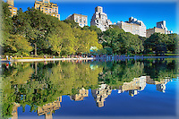 Looking at the reflection at NYC's Central Park Conservatory Water in the late afternoon sunlight.