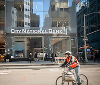 A New York branch of the Los Angeles based City National Bank in Midtown Manhattan on Friday, January 23, 2015. The bank, which is associated with the entertainment industry, will be purchased by the Royal Bank of Canada for $5.4 billion. CNB will remain a separate brand of RBC. (© Richard B. Levine)