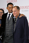 """WESTWOOD, CA. - December 16: Actors Will Smith and Woody Harrelson arrive at the Los Angeles premiere of """"Seven Pounds"""" at Mann's Village Theater on December 16, 2008 in Los Angeles, California."""