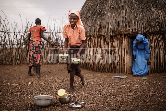 Women in a hut  in Kakuma refugee camp in Kenya.Kakuma refugee camp in North of Kenya. Kakuma is the site of a UNHCR refugee camp, established in 1991. The population of Kakuma town was 60,000 in 2014, having grown from around 8,000 in 1990. In 1991, the camp was established to host the 12,000 unaccompanied minors who had fled the war in Sudan and came walking from camps in Ethiopia.