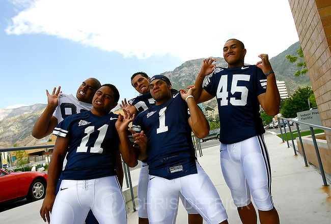 Provo, UT--8/10/06--3:55:39 PM-.BYU's Manase Tonga, #11,  Fui Vakapuna, #1, Harvey Unga, #45, Matangi Tonga, #99 (back left) and  Vic So'oto, #37, back right, pose for pictures during Media Day...****.This is BYU's media day. Pat Kinahan and Jay Drew will be on site, story is developing, he will know later in the week who we're going to shoot, and I'll update photo assign. thx...Chris Detrick/Salt Lake Tribune.File #_2CD7791..