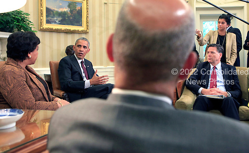United States President Barack Obama meets with Attorney General Loretta Lynch and FBI Director James Comey in the Oval Office of the White House in Washington, DC on  July 19, 2016. Jeh Johnson the Secretary of the Department of Homeland Security is the foreground.   ISP pool Dennis Brack/Black Star<br /> Credit: Dennis Brack / Pool via CNP