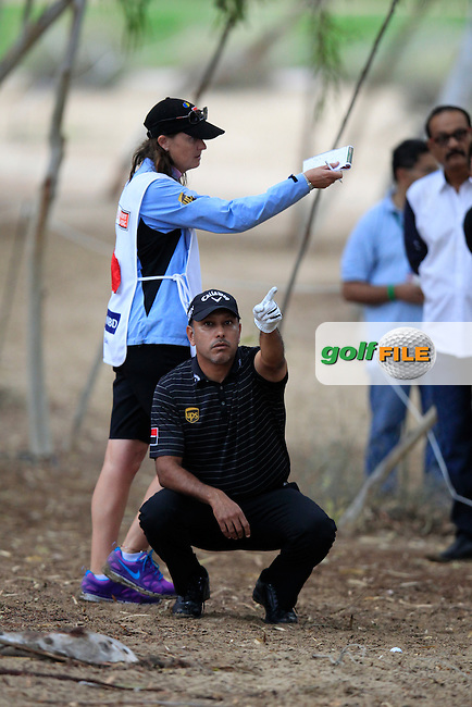 Jeev Milkha Singh (IND) and caddy Janet Squires assess his 2nd shot from the rough on the 18th hole during Saturday's Round 3 of the 2013 Omega Dubai Desert Classic held at the Emirates Golf Club, Dubai, 2nd February 2013..Photo Eoin Clarke/www.golffile.ie