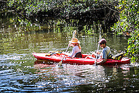 Visitors paddle down Estero River at Koreshan State Historic Site, a 200-acre park, Estero, Florida, USA. Photo by Debi Pittman Wilkey.
